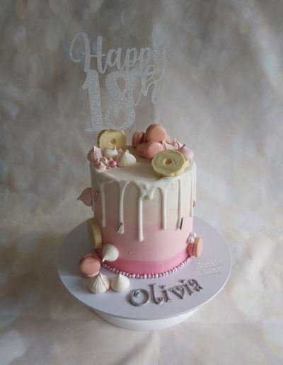 Birthday drip cake with biscuits and meringues