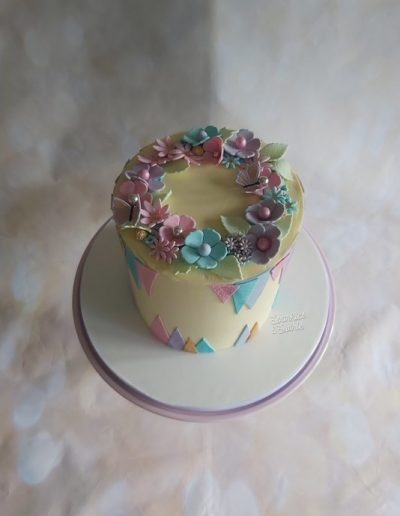 Modern geometric design birthday cake with floral garland