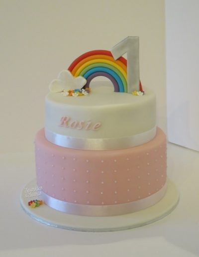 Children's two tier first birthday cake with rainbow decoration