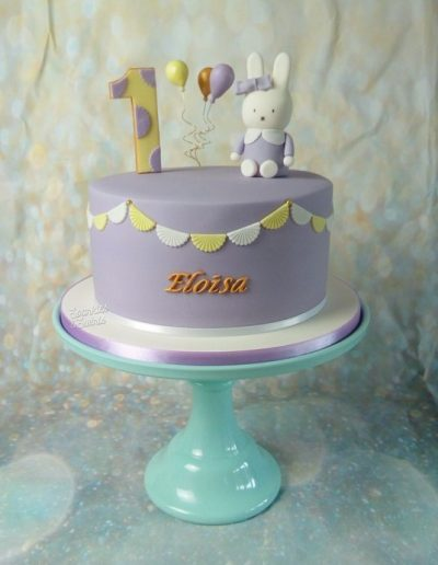 Children's birthday cake with character model and bunting decoration