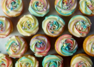 Pretty rainbow cupcakes with sprinkles