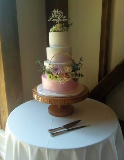 4 tier wedding cake withstanding hottest day on record